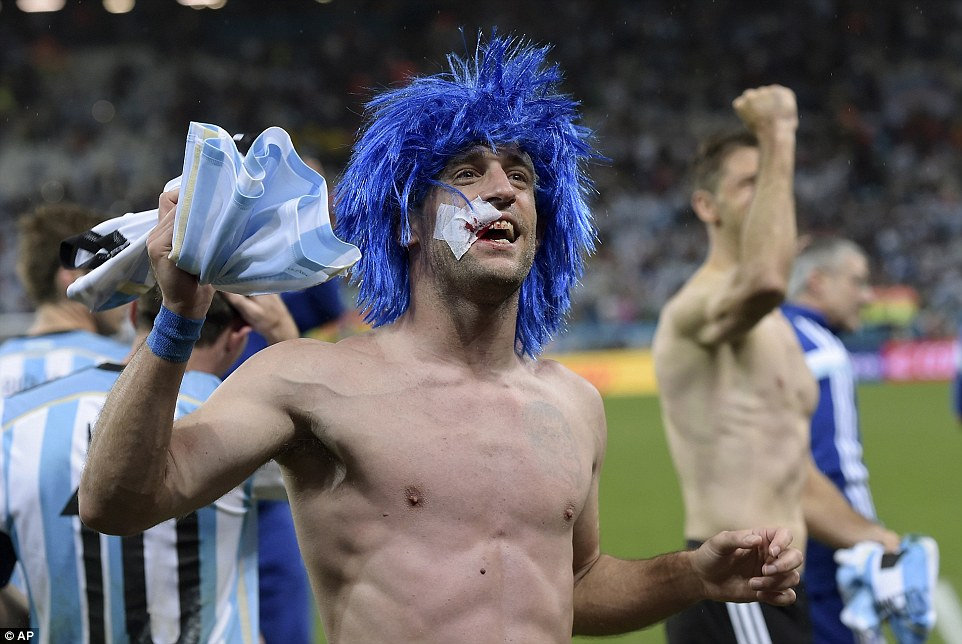 Argentina's Pablo Zabaleta celebrates after winning a shootout at the end of the World Cup semifinal soccer match between the Netherlands and Argentina at the Itaquerao Stadium in Sao Paulo Brazil, Wednesday, July 9, 2014. Argentina won 4-2 on penalties after the match ended 0-0 after extra time.  (AP Photo/Manu Fernandez)