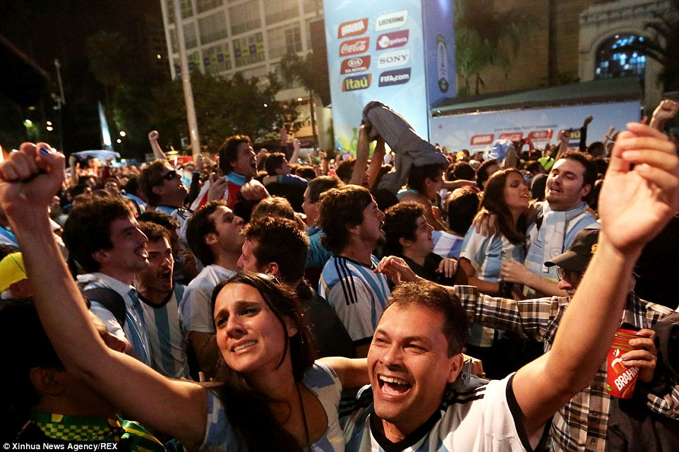 Mandatory Credit: Photo by Xinhua News Agency/REX (3907317f)  Argentina's fans react  Holland v Argentina, 2014 FIFA World Cup football match, Semi Final, Estadio Mineirao, Belo Horizonte, Brazil - 09 Jul 2014  Argentina won 4-2 on penalties over Netherlands after a 0-0 tie and qualified for the final