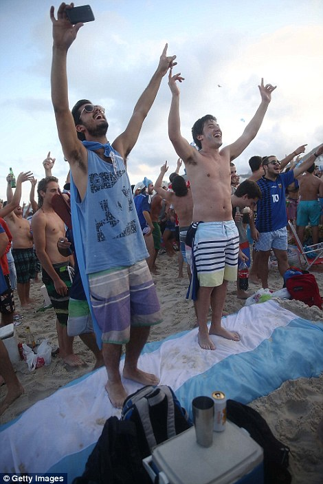 Argentina fans gather on Copacabana Beach before the start of their match against the Netherlands