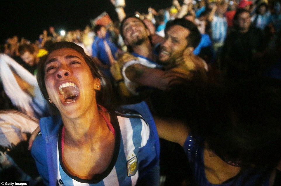 RIO DE JANEIRO, BRAZIL - JULY 09:  Argentina fans celebrate on Copacabana Beach after their dramatic shootout win in their match against the Netherlands in the 2014 FIFA World Cup on July 9, 2014 in Rio de Janeiro, Brazil. Argentina advances to the final match at Maracana.  (Photo by Mario Tama/Getty Images)
