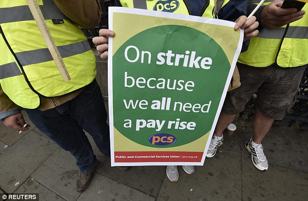 Message: Strikers in London say that their pay and conditions are unnacceptable