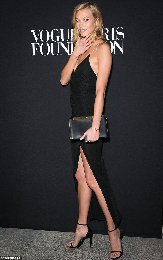Shy-high success: Karlie Kloss showed off her supermodel credentials as she arrived at the Vogue Foundation Gala on Wednesday in Paris