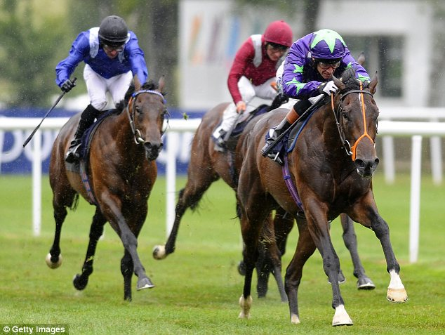 Impressive: Richard Hughes riding Ivawood wins the July Stakes at Newmarket on Thursday