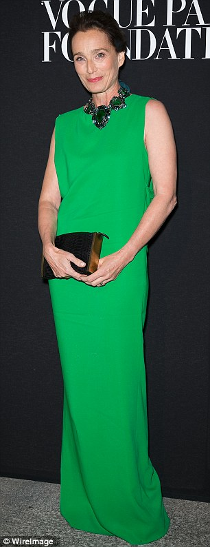Effortless elegance: Kristin Scott Thomas looked lovely in a bright green gown, while Vogue editor Anna Dello Russo opted for a shimmering, plunging number