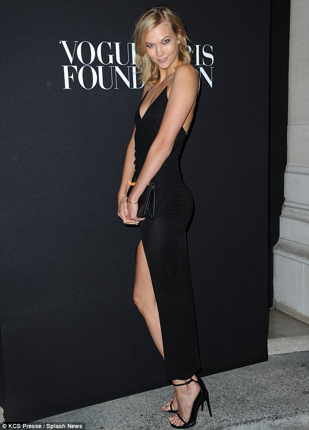 The thigh's the limit: Karlie Kloss showed off her perfect pins in a daring thigh-split number