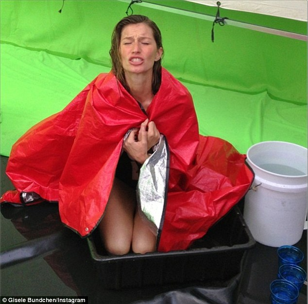 Tough job but someone has to do it: Supermodel Gisele Bundchen shivered as she knelt in a bowl in a selfie she posted with the caption 'Freezing at work #specialproject ???? ??'
