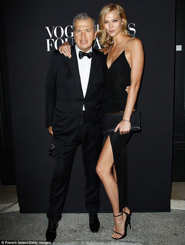 Photographer pal: Karlie posed with celebrity snapper Mario Testino who looked dapper in a dinner suit and bow tie