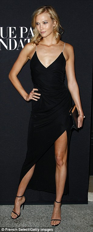 Model behaviour: Karlie Kloss rocked a daring thigh-split gown, while Joan Smalls slipped into a racy sheer skirt at the Vogue Foundation Gala in Paris on Wednesday night