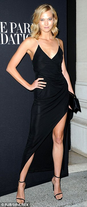 Leggy lovely: Karlie ensured her statuesque figure was on display to perfection as she posed up a storm at the fashion bash