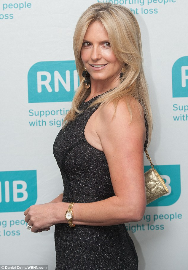 Posing up a storm: The 43-year-old wore her blonde tresses down while carrying a gold handbag on her shoulder