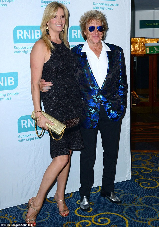Causing a stir: The 69-year-old old crooner chose a vibrant blue patterned jacket for the event