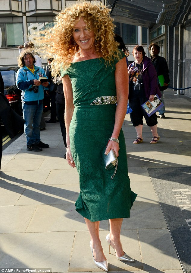 Elegant: Despite the weather, the Dragon's Den beauty managed to looked stunning in a beautiful green dress