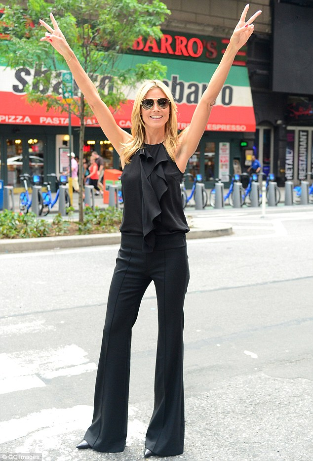 Feeling excitable: Heidi seemed to be in very high spirits earlier in the day when she took part in a photoshoot in Times Square