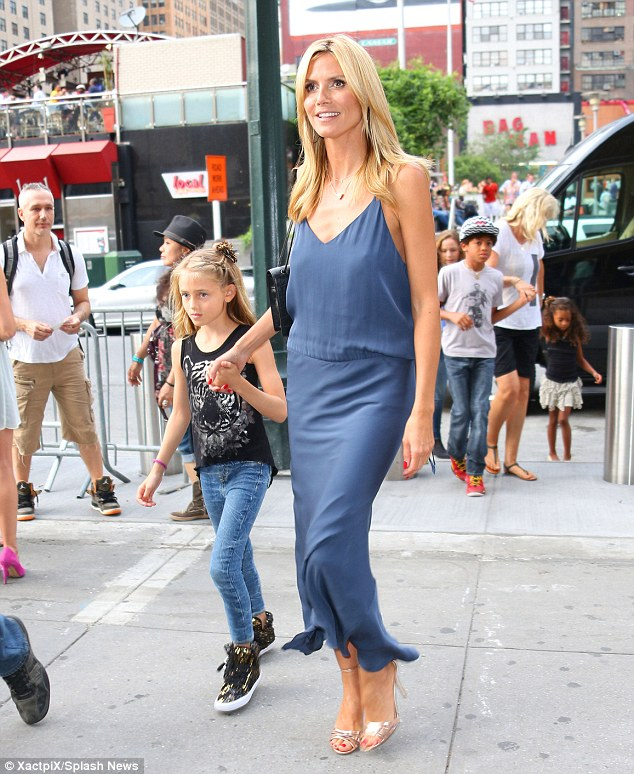 Stylish! The German born model walks hand in hand with lookalike daughter Leni