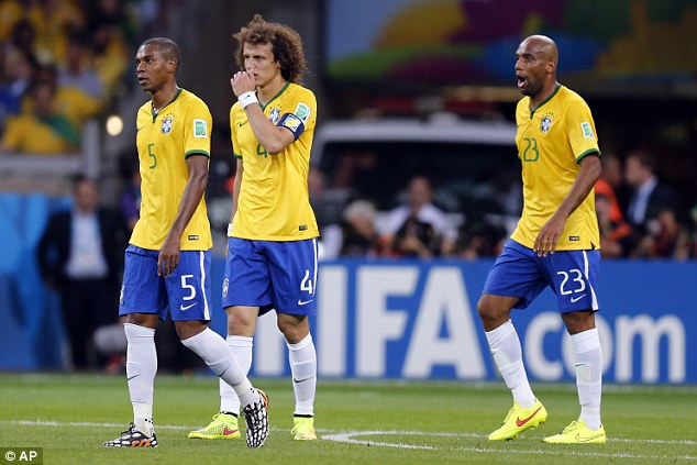 Defeated: Brazil's Fernandinho, David Luiz and Maicon (from left) walk after Germany scored their fifth goal