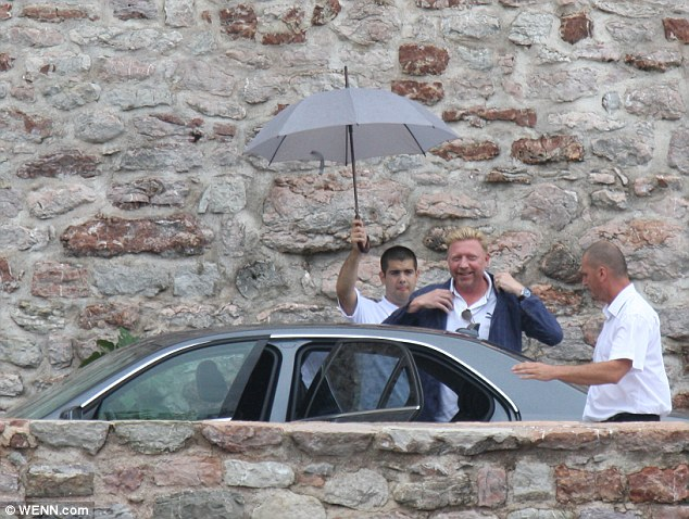 Famous faces: Tennis legend Boris Becker was pictured as he arrives in Montenegro for the wedding