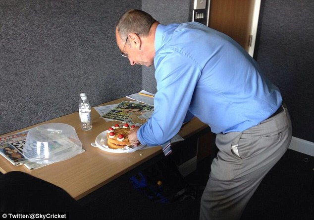 Tucking in: Bumble gets stuck into a Victoria Sponge
