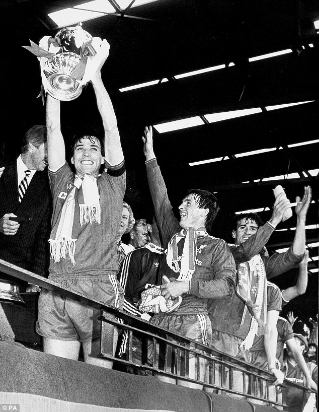 Born winner: Hansen, the Liverpool captain, holds the FA Cup aloft after beating Everton in the 1986 final at Wembley