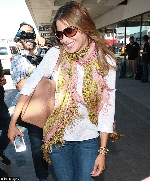 Loving the attention: She seemed to take great delight as she caused a stir on her birthday at the airport