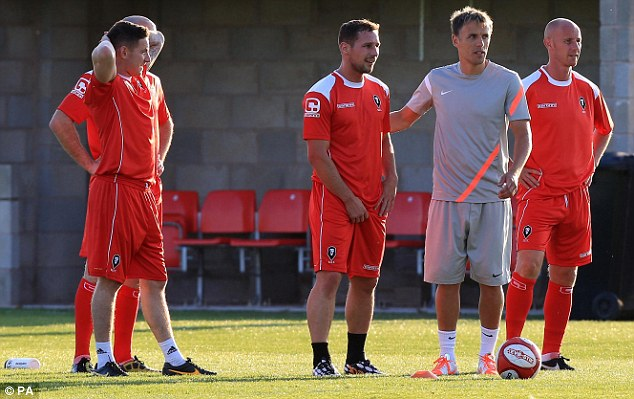 Assistance: Manchester United coaches Neville and Butt help train members of Salford City's first team