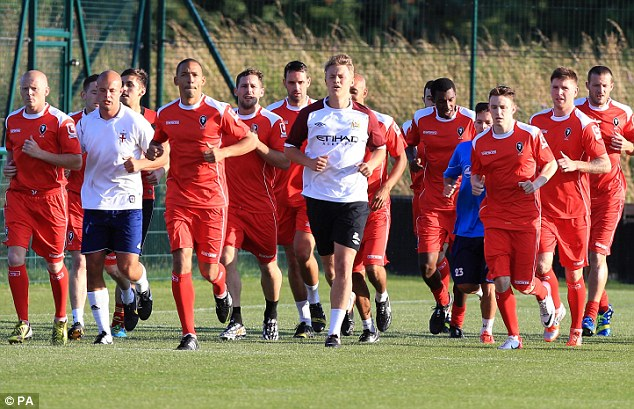 Team spirit: Salford City's first team are made up of players from the local community