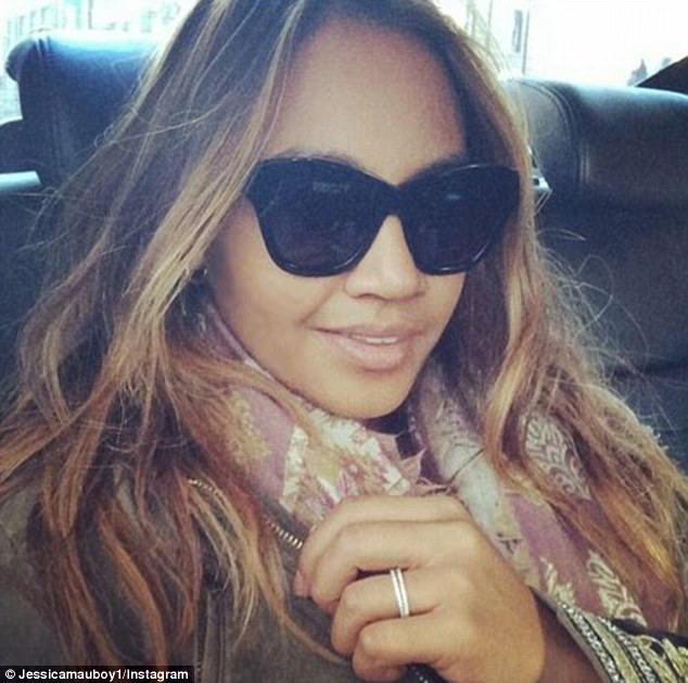 Something to tell? Jess sparked rumours of an engagement to her boyfriend of five years Themeli Magripilis, after she was photographed wearing a s sparkler on 'that' finger
