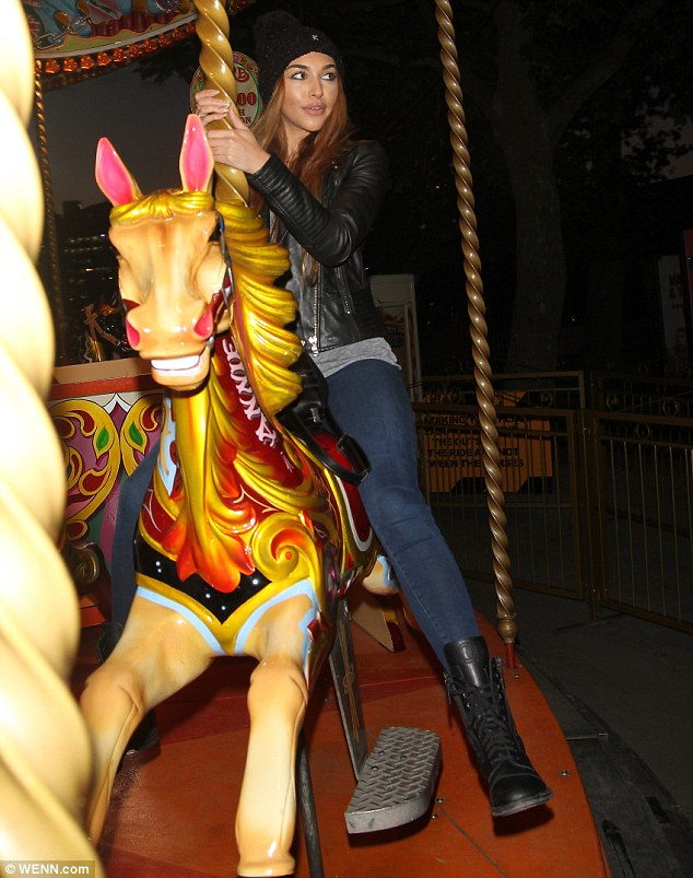 Child at heart: The 21-year-old certainly seemed to be enjoying herself on the carousel