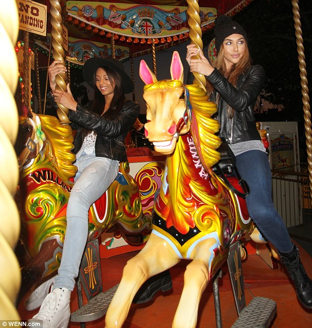 Ride of her life: Chantel Jeffries (R) was seen at a fairground on Thursday in London