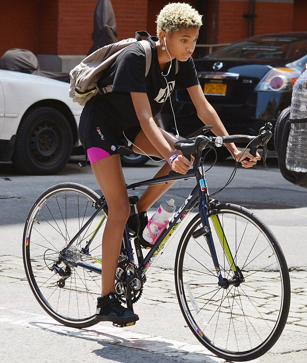 Sporty with an edge: The platinum blonde wore a black T-shirt, black-and-pink shorts and a pair of high-top tennis shoes
