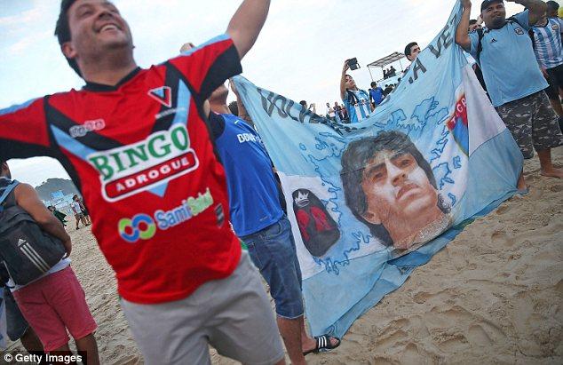 backing: Argentine fans with a flag of Diego Maradona on Copacabana Beach