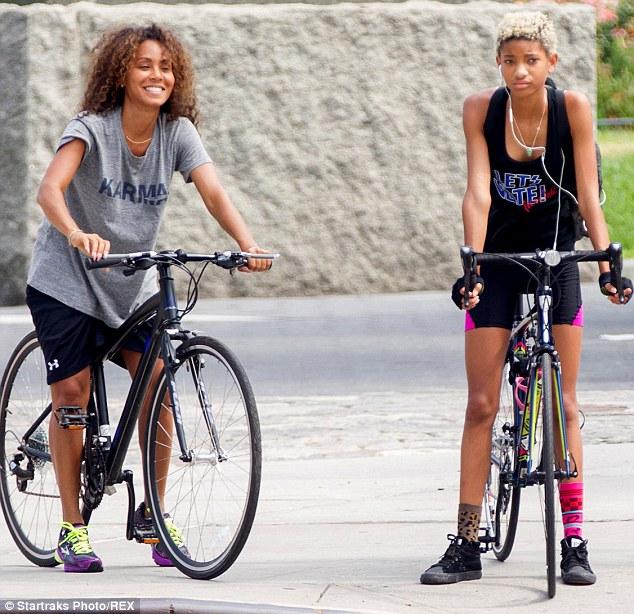 Bonding: On Tuesday, Willow was seen riding her bike with her mum Jada Pinkett Smith, left