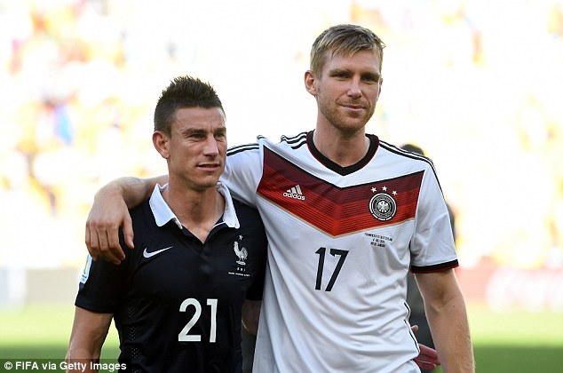 Team-mates: Mertesacker and Arsenal teammate Laurent Koscielny after the semi-final