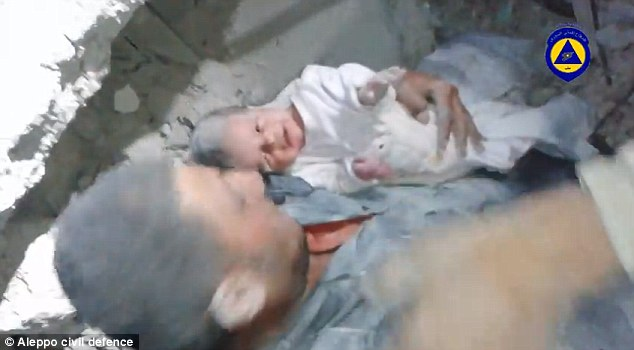 Free: The crying child is handed over to one of the rescue workers to hold