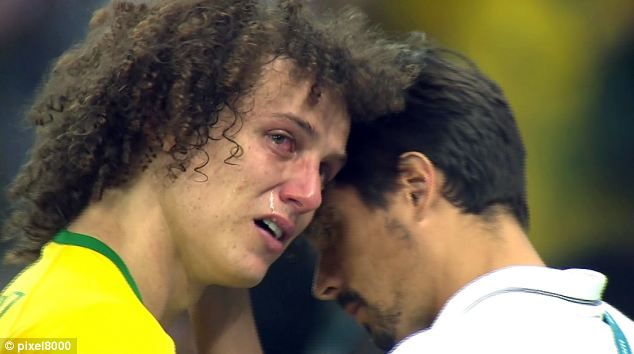 Brazil's David Luiz, pictured left, wept after his side was thrashed 7-1 by Germany in the World Cup semi-finals