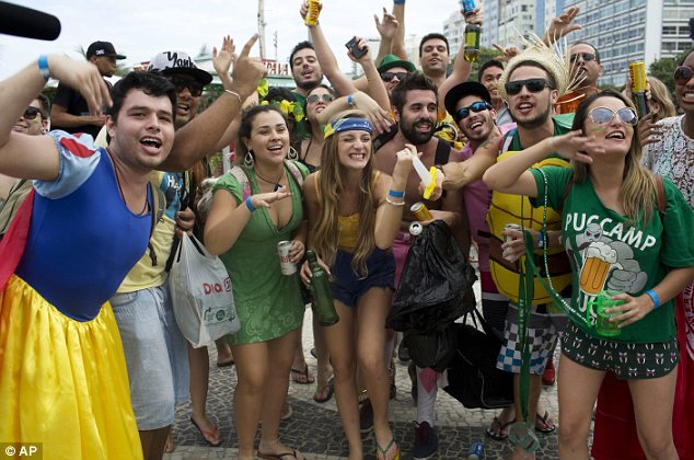 Rivals: Argentina and Brazil fans (below) trade chants on Copacabana Beach on Saturday