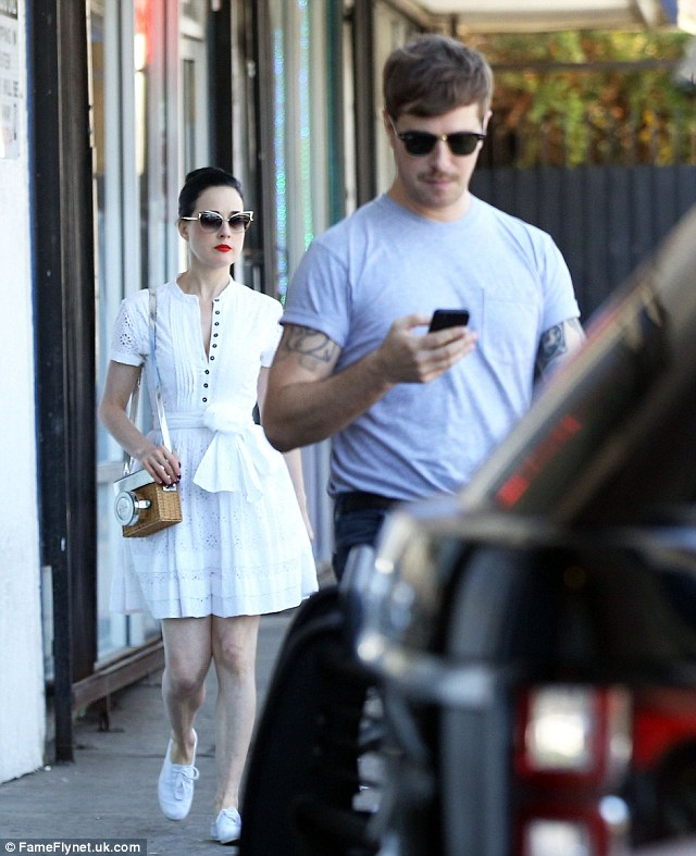 Looking all-white: Dita looked gorgeous in her white shirt dress