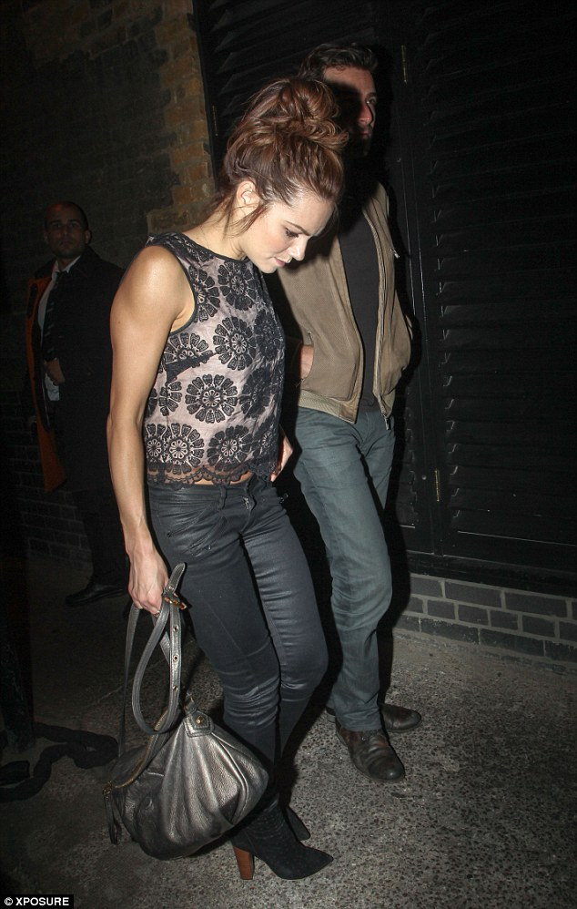 Low profile: The pair seem to be leaving The Chiltern Firehouse via a side entrance rather than the front