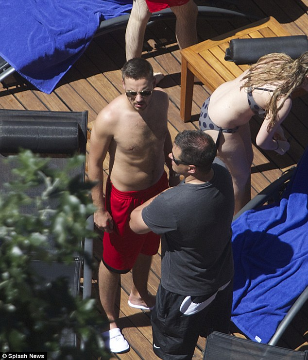 Getting it off his chest: Liam Payne soaked up the sun in Madrid poolside before 1D's concert in the city