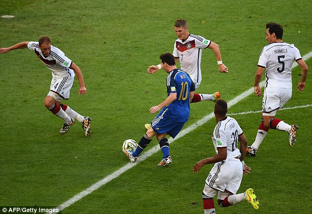 Marked man: Lionel Messi surrounded by four German players as he breaks forward