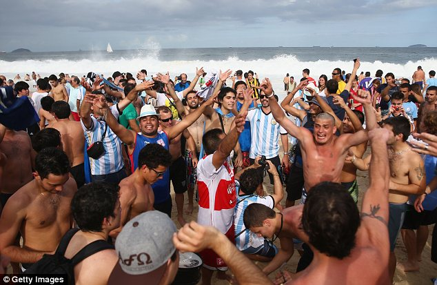 Colourful: Argentina fans gather on Copacabana Beach on Saturday ahead of the World Cup final