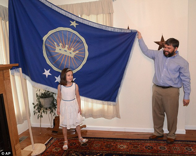 Royalty: Princess Emily and her adventurer father Jeremiah Heaton show off their flag
