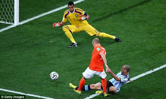 Tackle of the tournament: Javier Mascherano denied Holland's Arjen Robben in the closing stages of the semi-final