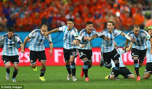 Relief: Argentina celebrate their penalty-shootout victory over Holland in the semi-final