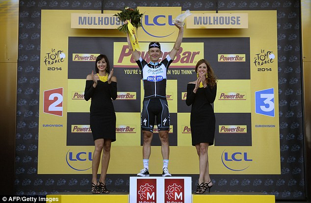 Enjoyment: Stage winner Germany's Martin celebrates on the podium after winning the 170km ninth stage