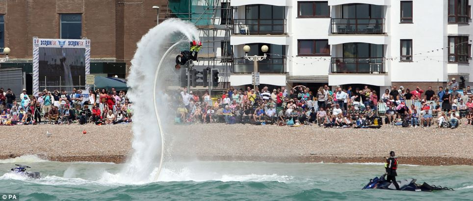 Spectators at the annual Worthing International Birdman competition in Sussex were bathed in sunshine as they watched people throw themselves off the town's pier to 'fly' unassisted