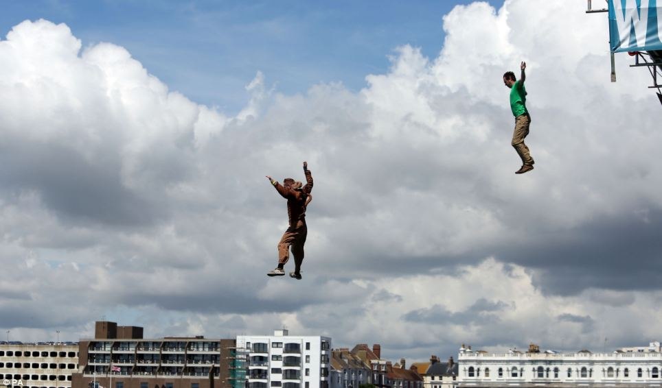 Mark and Nicholas Roberts, dressed as characters from Scooby-Doo jump from Worthing pier during the International Birdman competition