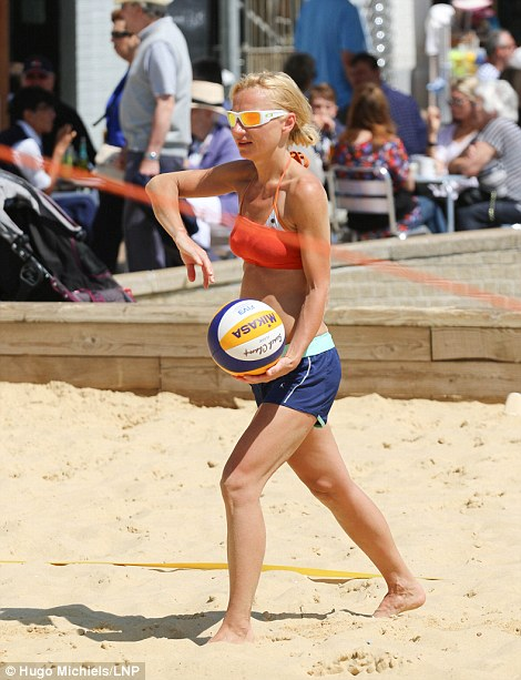 A woman plays beach volleyball in Brighton