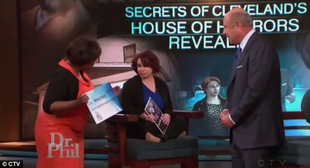 Phil McGraw of Dr. Phil television fame presented Michelle Knight with an oversized check for more than $400,000 from his foundation