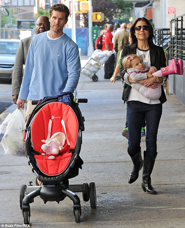 Happier times: The TV star and her then-husband Jason Hoppy - pictured in May 2012 with their daughter prior to their split - were embroiled in a bitter custody battle over the youngster, with an agreement finally being reached just last month