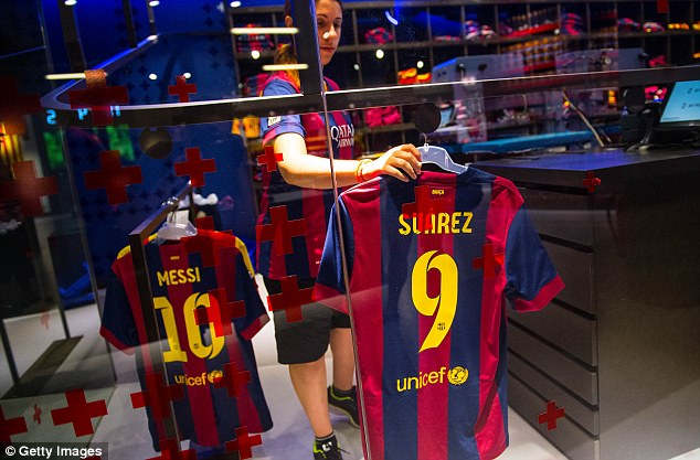 Number nine: They might not be able to unveil him but Barcelona fans can already buy Suarez's shirt